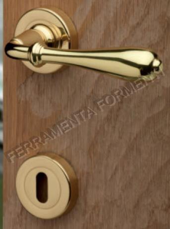 Maniglia porta ghidini modello novecento materiale ottone - Materiale maniglie porte ...
